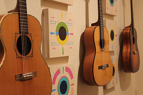Instruments and inspired art, including guitars from Craig Wilson and pieces by Janet Essley, pictured above, bring together the  art of instrument building and mixed media pieces, on display now through April 2 at the Columbia Center for the Arts.