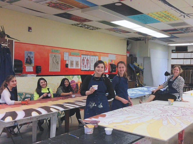 Members of Hood River Valley High School's National Art Honor Society and local mural artist Allison Bell Fox, above, created murals for both the exterior and interior of the school's health center, installed earlier this month. Themes ranged from nutrition to oral health, as seen below.
