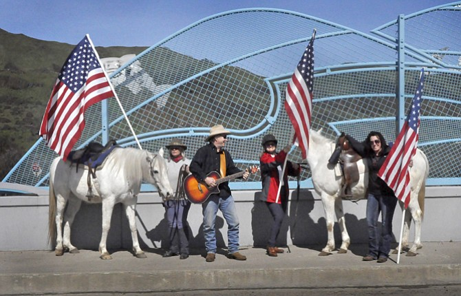 """A group of Wasco County residents joined the national """"Ranchers' Lives Matter"""" movement Saturday by holding a rally at a local freeway overpass to focus attention on issues brought to light by the recent standoff in Burns."""