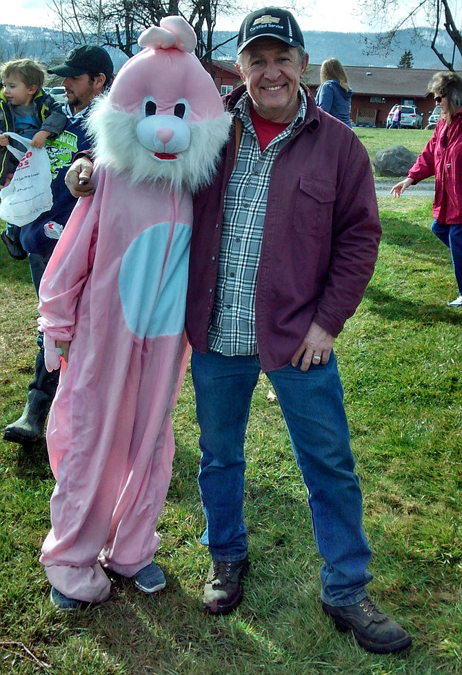 Eagles volunteer Jerry Cox spent a little time with Larson's Clothes Easter Bunny at the Grangeville egg hunt, sponsored by the Eagles, March 26.