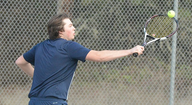 Grangeville competed at Clearwater Valley last Thursday, but action was halted when a storm moved in. Pictured, TJ Wiltse connects with a backhand shot during mixed doubles play.