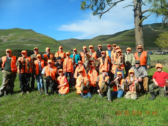 """From among the more than 200 who participated in hunter education courses across the area this spring, 25 chosen by their instructors joined the Youth All-Star Hunt last Saturday, March 26, at the Flying B Ranch. Among those who helped make it possible are conservation officers, volunteer instructors and the Flying B Ranch, as well as parents, grandparents and the students themselves. """"In a time where everything goes so high-tech so fast, where there's so much immediate gratification, it's so nice to slow the world down and enjoy the things that make Idaho and Idahoans so great,"""" district conservation officer George Fischer said. """"This is so much more than hunter education and so much more than a youth hunt, because there's so many lessons to be learned. We're so proud of these kids, and the people who step up to help.""""  Among those pictured are Fischer, First Hunt Foundation organizer Rick Brazell, Roy Kinner, Pres Funkhouser, Larry Thatcher, Kyle Christopher, Nick DeBolt, Ethan Bishop, Mike Paul and Mark Rambaugh, and not pictured are Kevin Asker, Bill Seybold, Jen Bruns and Pat Hilton. Fischer highlighted two other organizations: the Idaho Department of Fish and Game, and the National Wild Turkey Federation."""