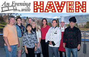 Chefs donating their skills and time stand with representatives of HAVEN for a photo on the deck of the Fort Dalles Readiness Center. Pictured are, left to right; Jim Olheiser of Cowboy's Catering; Courtney Gallant, health development coordinator for HAVEN; Monitira Sommerfelt of Montira's Thai Cuisine; Steve Light of Freebridge Brewing; Tara Koch, executive director of HAVEN; Michelle Bell, manager of The Bistro at Water's Edge; Jorge Barrangan of Casa El Mirador; Chris Hance of Cousin's Restaurant and Saloon and Amadeo Angulo of Casa El Mirador. Not pictured are Bill and Connie Ford of Zims Brau Haus will also join the chefs at an Evening with HAVEN.