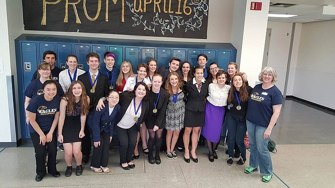 COACH DeLona Campos-Davis and members of the HRVHS Speech and Debate team celebrate their win Saturday at Hood River Valley High School.