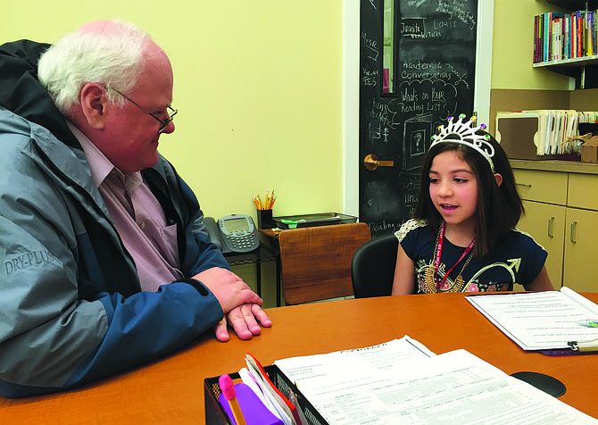 Princess-ipal Isabell Garcia-Becerra (right) consults with Assistant Superintendent Rich McFarland on Friday.