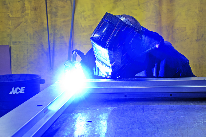An employee at MAK Metal welds a component on Monday. The company recently finished an expansion.