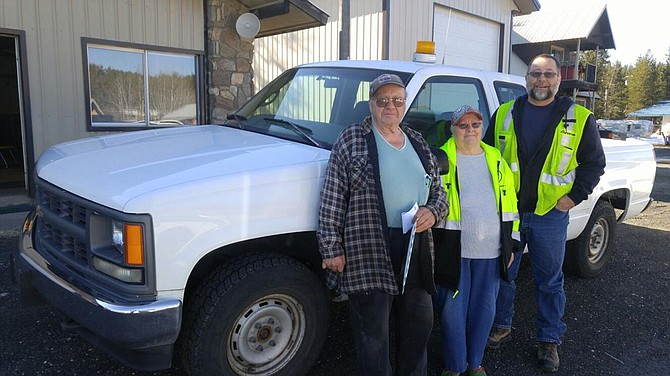 Elk City Volunteer Fire Department chief Loren Anderson (left) and his wife Cocoa accept an Avista pickup from Grangeville  Local Rep Eric Robie.