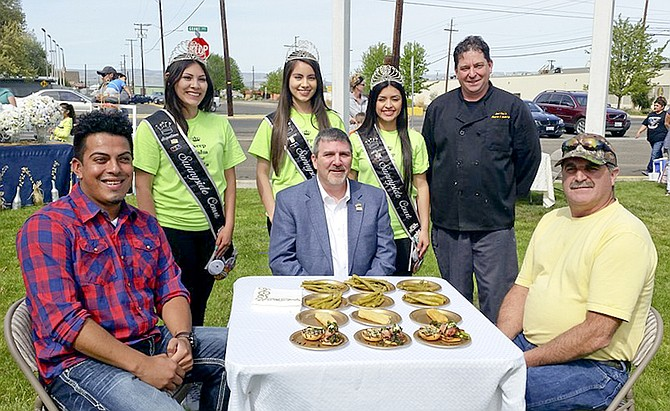 Judges Raymond Castro-Escobar, Mayor Jim Restucci and Tom Dolan sit with asparagus dishes. Sunnyside Princesses Jaquelinne Herrera-Bravo, Lucero Mejia and Alyssa Ceja stand in the back with Chef Roger Hazzard.