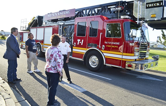 Sunnyside City Council members and the public pause to admire the city's new ladder truck, which arrived earlier this month.