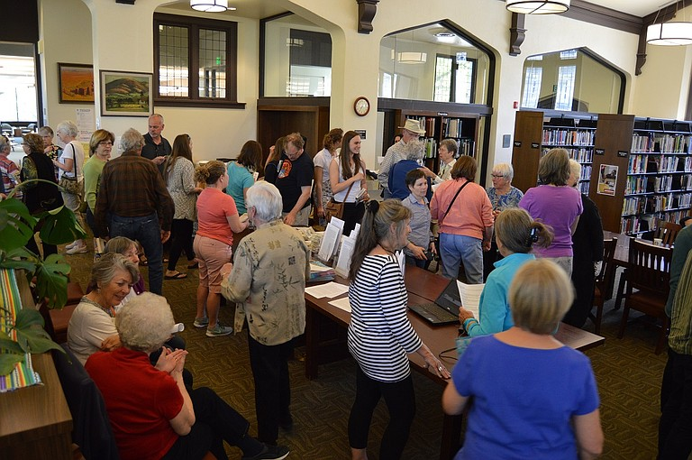 """A crowd of 50-plus gathered at the Hood River Library on April 17 for the kickoff book distribution event. This year's selection is """"Martin Marten"""" by Oregon author Brian Doyle."""