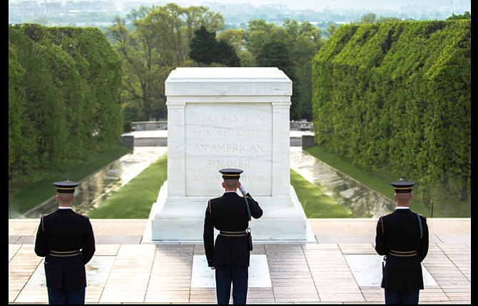 """Members of the """"Old Guard"""" pay respects to the Unknown Soldier interred almost 100 years ago at Arlington National Cemetery in Virginia. Sentinels are now on the move to start a """"National Salute"""" to commemorate that anniversary and a new documentary about service and sacrifice called """"The Unknown"""" is part of that public awareness campaign.  Contributed Photo"""