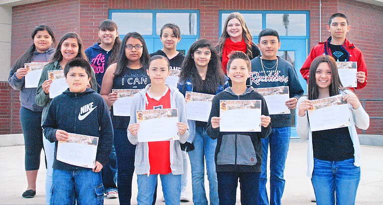 Harrison Middle School's April Students of the Month are, front row, left to right, Ezequiel Ayala, Sylvia Alvarez, Leif Van Doren, and Erica Barajas; second row, Jessica Robles, Perla Mendoza, Michelle Vasquez and Jose Campusano; and back row, Sarai Rodriguez, Julyssa Vargas, Yarisi Gomez, Samantha Norem and Pedro Hernandez. Named students of the month, but not pictured, are Ethen Dominguez, Itzel Ramirez and Nancy Vargas.