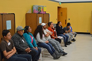 """Families gathered at Wy'east Middle School April 28 for the last of the school's Juntos sessions. Before """"graduating"""" from the program, they shared a meal together, and then shared what they learned during their five weeks together. Families also created action plans and had the opportunity to speak with Juntos Club founders from Hood River Valley High School."""