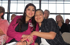 Gaby Ugarte sits with her son Raymond, 14, during a May 5 speech by Pam Tebow at a Columbia Gorge Pregnancy Resource Centers' fundraiser in The Dalles that drew nearly 400 people. Ugarte works for the organization and shared her story about choosing to be a teen mom instead of having an abortion as she was urged to do.