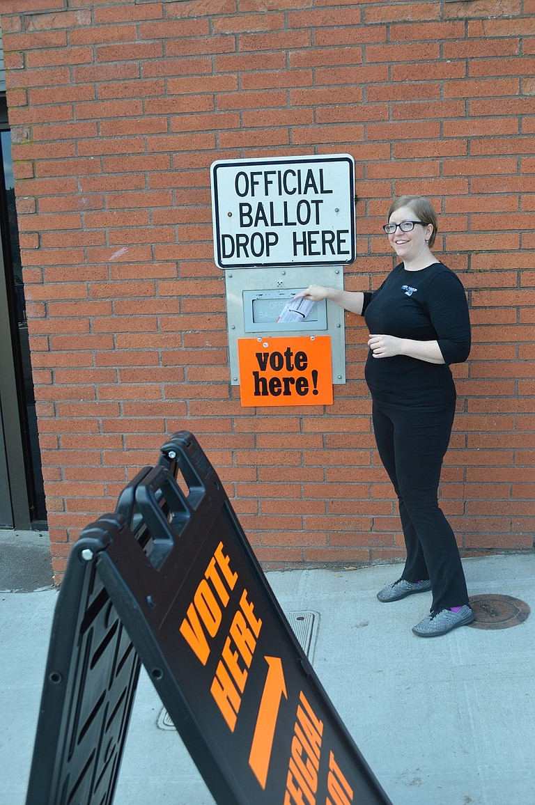 Joanna Holmes drops off her ballot Monday at the Hood River County Administration building.
