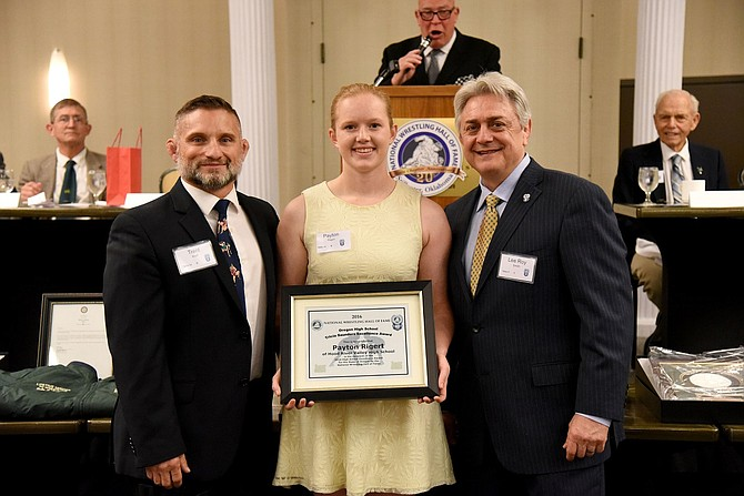 PAYTON RIGERT (center) receives her Oregon Outstanding Female Wrestler of the Year award from the National Wrestling Hall of Fame during the Oregon Wrestling Hall of Fame banquet that was held recently in Portland. At left is HRVHead Wrestling Coach Trent Kroll. At right is NWHF Executive Director Lee Roy Smith. The award caps what has been an illustrious, four-year high school wrestling career for Rigert, who will continue competing in the sport in college.