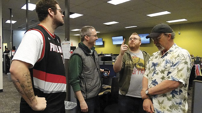 Scott Herbert, Rich Miller, TJ Geise and Brock Wallace share a light moment while at work.