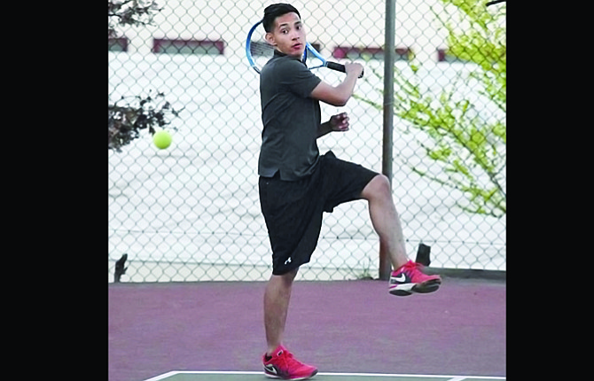 The Dalles tennis player Luis Diaz hits a return volley in his doubles match played earlier this season. Last week, Diaz and the Riverhawks fared well in Special District 1 action in Hermiston.