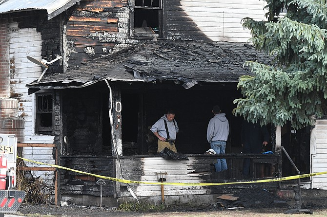 Omak Fire Chief Kevin Bowling investigates the scene of an early morning fire on Monday. We will have information on the North Ash Street fire today.