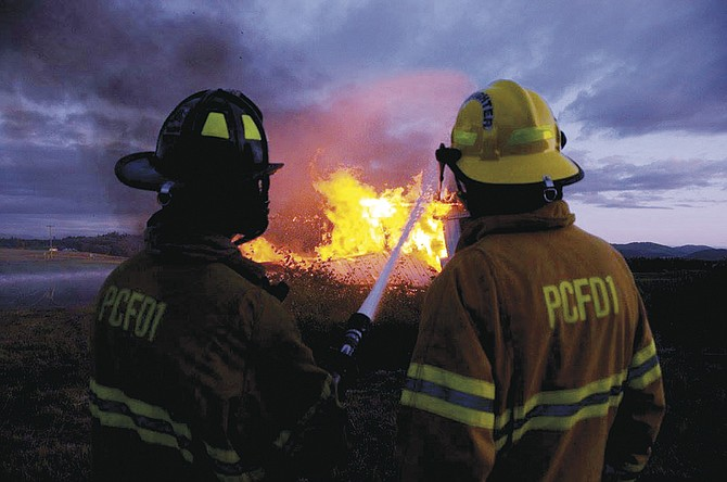 "Firefighters with Polk Fire No. 1 train at a ""burn to learn"" exercise last week."