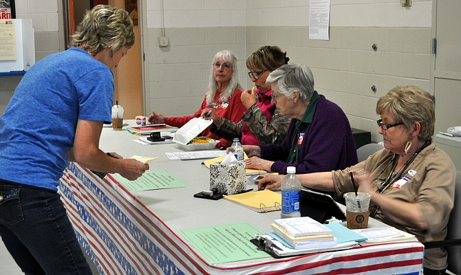 A voter receives assistance at the Grangeville polling station May 17.