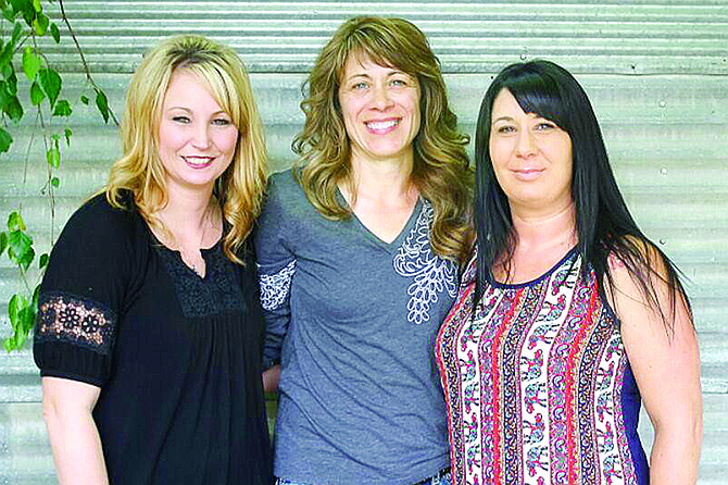 Jenny Gardinier (center) poses with stylist Alicia Wallis (left) and new salon owner Heather Ferry (right).