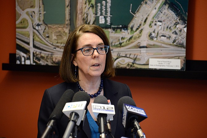Oregon Gov. Kate Brown speaks at a press conference regarding the fiery Mosier train derailment Friday night.