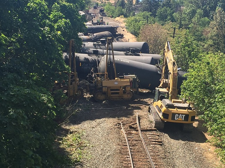 Photo courtesy of Oregon Department of Transportation. Crews work on scene at about 4 p.m. Saturday June 4, 2016 at the site of a Union Pacific train derailment just west of Mosier.