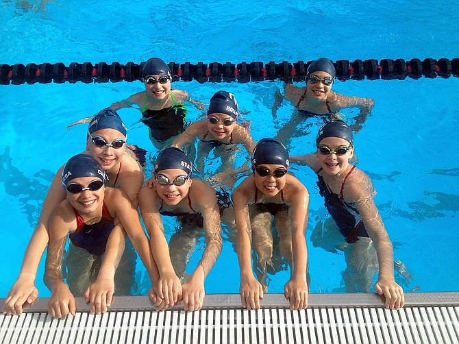 Swimmers who competed in the A/B meet (50-yard pool). Front row from left to right: Marina Castaneda, Shea Kasenga, Skyla Hollowell, Michelle Graves, and Thea Smith. Back row from left to right: Sophia Kaden, Willow Hollowell, and Nora Sandoval.