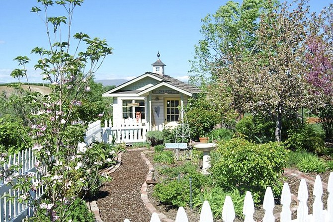 Admiring local gardens, like this Selah Cottage Garden, is the focus of this weekend's 2016 Garden Tour.