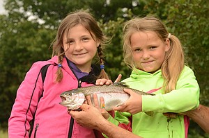 A local pair who has fished at the event many times before nabbed the day's first fish with some help from Kevin Barger (not pictured). Their rainbow measured 19 inches. Addie Vanderwall hooked it and reeled it in, and Carys Barger helped her get it to the check-in station.