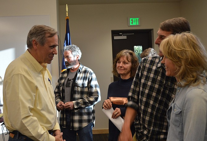 SEN. JEFF MERKLEY held a well-attended town hall at Ty Taylor Fire Hall in Hood River Saturday evening. Citizens talk casually with Merkley after the meeting, in which the U.S. senator highlighted oil train safety among other issues.