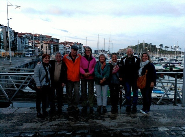 WRITER Peggy Dills Kelter, center, with friends at the Basque harbor of Lekeitio.