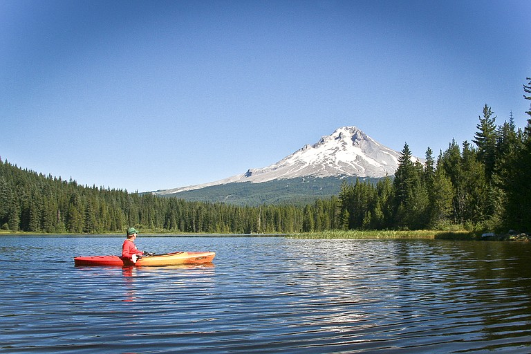 Pastor Tim Pettey says it is okay to rest the paddle across one's lap and rest, like his friend enjoying Trillium Lake, near Mount Hood in Central Oregon.