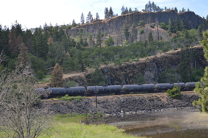 OIL TRAIN stopped at Mosier on June 3, when 16 cars derailed and four caught fire. Union Pacific will resume oil train traffic through the area, despite objections from local and state policymakers. A federal report blamed UP for the derailment.