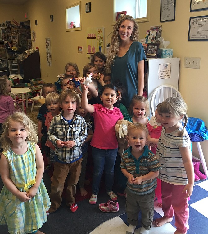 Julia Skwarczynski took her love of languages to three local preschools this spring for her HRVHS EA project. Above, Skwarczynski teaches German to students at Our Children's Place.