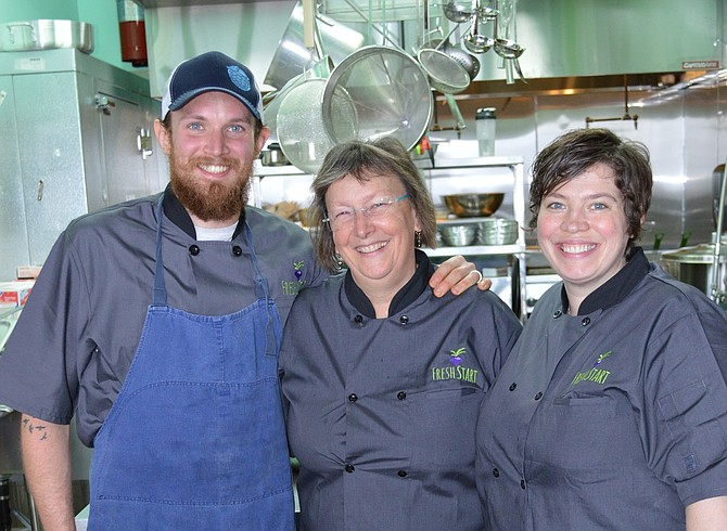 FRESH START staff director Kathy Watson, center and instructors Matt Patterson and Rainbow Trosper. The staff served a recent meal to Hood River Rotary in the program's home, the kitchen at Riverside Community Church.