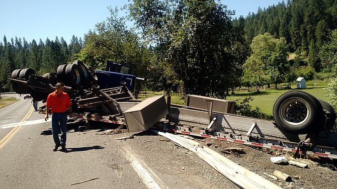 A logging truck overturned on State Highway 13 on Monday, June 27, and partially blocked the southbound lane.