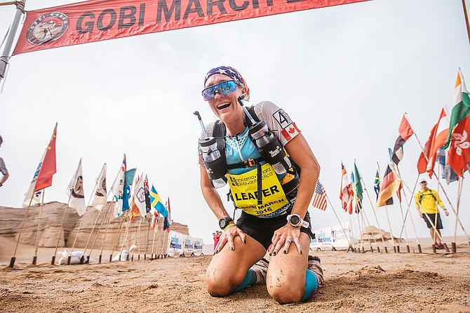 JAX MARIASH KOUDELE drops to her knees with relief after completing the 155-mile Gobi March race of the 4 Deserts series. Koudele, a Hood River resident, placed first in the women's category, and sixth overall in the event.