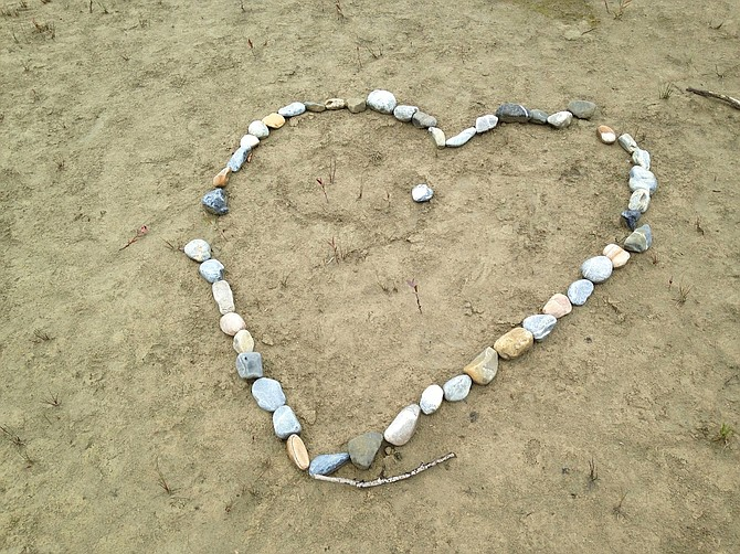 """""""While trekking along a sandbar, I came across an assemblage of stones in an almost perfect shape of a heart ..."""" — Peter Marbach"""