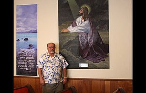 Maj. Ronald Wildman, an ordained minister with the Salvation Army since 1988, stands in the house of worship at the service organization's location at 623 E. Third St. in The Dalles. Wildman said he does not understand why some city officials don't consider the Salvation Army facility as a church.