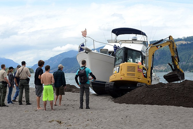 This Bayliner vessel, owned by John Herrin out of the Tri-Cities area, ran aground late Thursday night after the pilot strayed too far from the shipping channel and struck the Hood River sandbar.
