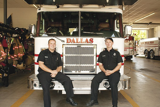 Austin Champ, left, and Jesse Friedow are Dallas' first paid firefighters. The two will provide seasonal help to the Dallas Fire Department during the peak fire season.