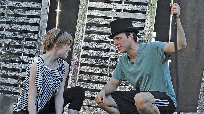 """Jeff Presler, right, and Sarah Cotter rehearse a scene from """"A Midsummer Night's Dream."""""""