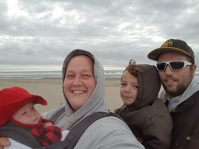 Kaius Johnson, second from right, enjoys a recent outing to the coast with sister Minnie, left, mother Crystal Noyes an stepfather Casy Wise. Kai recently underwent brain surgery, and a Zumbathon fundraiser has been organized for this Saturday, July 23 beginning at 9 a.m. at May Street Elementary.