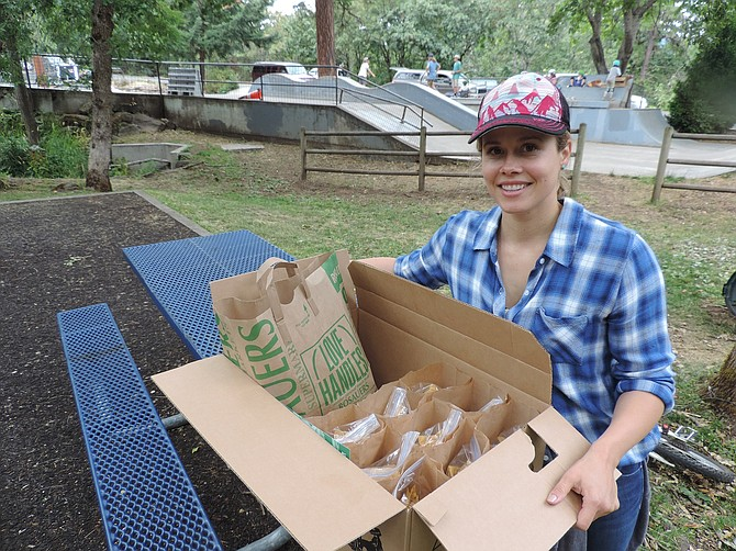 """""""WE ARE trying to reach people in need, and it's a work in progress to find the right places to reach out to people,"""" said Katie Haynie, who hands out food donated through FISH food bank this week at Hood River Skate Park, through Friday. Meanwhile, the Hood River School District summer meals program is on this week at Mid Valley Elementary and Hood River Valley High School."""