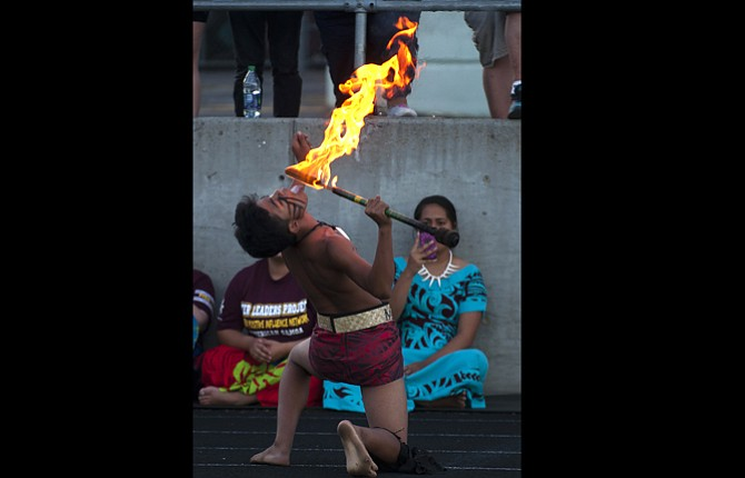 A champion fire dancer performs at a cultural exchange July 14 at Wahtonka Community School. A group of students from American Samoa spent a week with students from the community school. Local students plan to visit Samoa next spring.