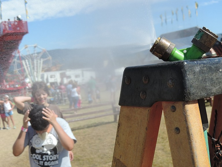 MISTING devices provide relief at various locations around the fair.