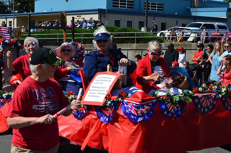 DAR members celebrate their Guinness World Record win during the Fourth of July parade in Hood River.