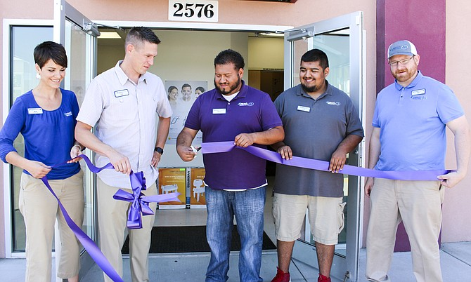 Celebrating its grand opening Friday, Howard's Medical Supply staff and CEO Erik Mickelson had a ribbon cutting at its Sunnyside location, 2576 Yakima Valley Hwy. Pictured, left to right are marketing team lead Beth Kalombo, Mickelson, Sunnyside team lead Mario Hernandez, customer service representative Frank Alegria and customer services representative team lead Nat Holland.